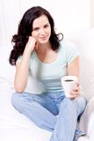 Smiling brunette woman drinking black coffee Royalty Free Stock Image