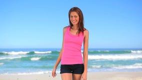 Smiling brunette woman enjoying the sun stock footage