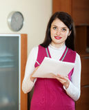 Smiling brunette woman with financial documents Royalty Free Stock Photo
