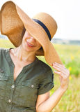 Smiling brunette woman in hat Royalty Free Stock Images