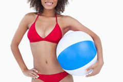 Smiling brunette woman holding a beach ball Royalty Free Stock Photo