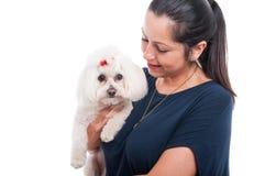 Smiling brunette woman hugging her cute dog Stock Images