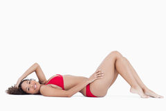 Smiling brunette woman lying down Stock Images
