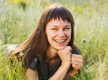 Smiling brunette woman on medow Royalty Free Stock Photography