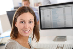 Smiling brunette woman in office Stock Photo