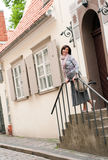 Smiling brunette woman in Old town Stock Image