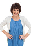 Smiling brunette woman placing hands on hips Stock Image