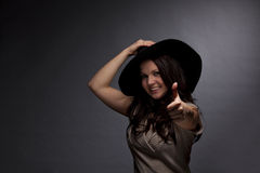 Smiling brunette woman posing thumbs up Stock Photos