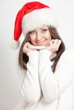Smiling brunette woman in santa hat Stock Photo