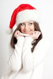 Smiling brunette woman in santa hat Royalty Free Stock Image