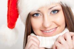 Smiling brunette woman in santa hat Royalty Free Stock Image