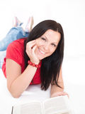 Smiling brunette woman studying Stock Photo