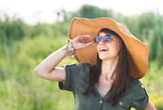 Smiling brunette woman in summer day Stock Photography