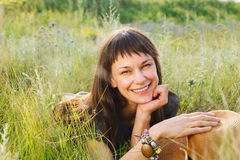 Smiling brunette woman in summer day Royalty Free Stock Images