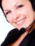 Smiling brunette woman talking by headp Stock Photos