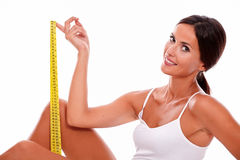 Smiling brunette woman with tape measure royalty free stock photos