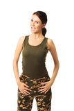Smiling brunette woman wearing military clothes Royalty Free Stock Image