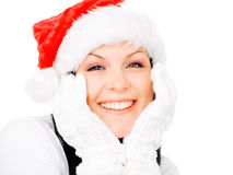 Smiling brunette woman in winter christmas clothes. Over white Stock Image