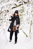 Smiling brunette woman in winter forest Stock Photos