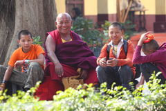 Priest. Buddhistic priest sitting with his students in the garden Royalty Free Stock Photo