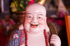 Smiling Buddha - Chinese God of Happiness, Wealth and Lucky Royalty Free Stock Photo