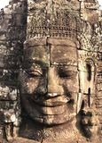 The Smiling Buddha Face. Is located at the Bayon temple, Siem Reap Cambodia royalty free stock photo