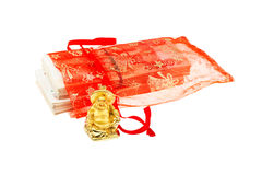 Smiling Buddha and russian fivethousand banknotes in gift bag Royalty Free Stock Photos