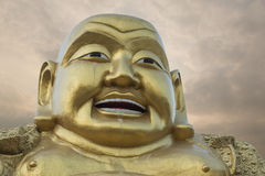 Smiling Buddha statue. Stock Photo