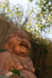 Smiling Buddha statue Royalty Free Stock Images
