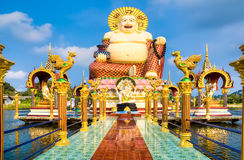 Smiling Buddha of wealth statue Royalty Free Stock Images