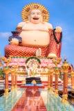 Smiling Buddha of wealth statue Stock Photo