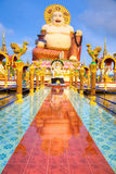 Smiling Buddha of wealth statue Royalty Free Stock Photos