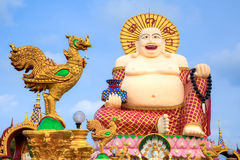 Smiling Buddha of wealth statue Stock Images