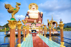 Smiling Buddha of wealth statue Stock Photography
