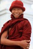 Smiling Buddhist novice Stock Images