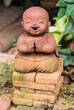 Smiling buddhist novice made of clay, Thai style Stock Image