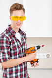 Smiling builder with a dril Stock Photos