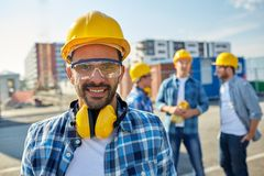 Smiling builder with hardhat and headphones Royalty Free Stock Photo