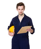 Smiling builder hold with clipboard Royalty Free Stock Photography