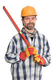 Smiling builder holds level Stock Images