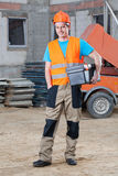 Smiling builder keeping toolbox Stock Photography