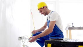 Smiling builder with tablet pc and equipment stock video footage