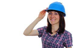 Smiling builder woman wearing protective blue helmet Royalty Free Stock Photo