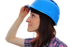 Smiling builder woman wearing protective blue helmet Royalty Free Stock Images