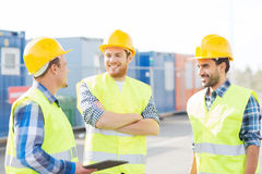 Smiling builders in hardhats with tablet pc Royalty Free Stock Images