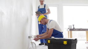 Smiling builders with tablet pc and equipment stock footage