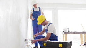 Smiling builders with tablet pc and equipment stock video