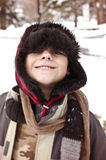 Smiling Bundled up Boy on Winter Day royalty free stock images