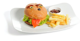 Smiling burger and fries Stock Image