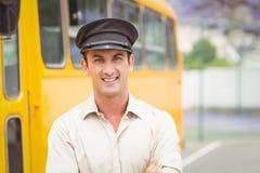 Smiling bus driver looking at camera Royalty Free Stock Photo